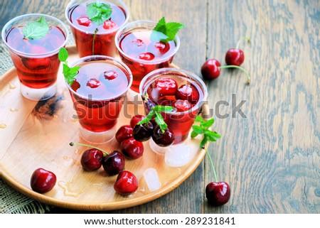 juice from the cherries, organic food - stock photo
