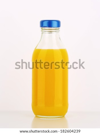 juice in the glass bottle with blue lid - stock photo