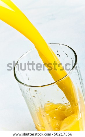 juice is poured into a glass closeup - stock photo