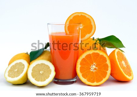 Juice of oranges and lemons produced in an organic photographed on white background