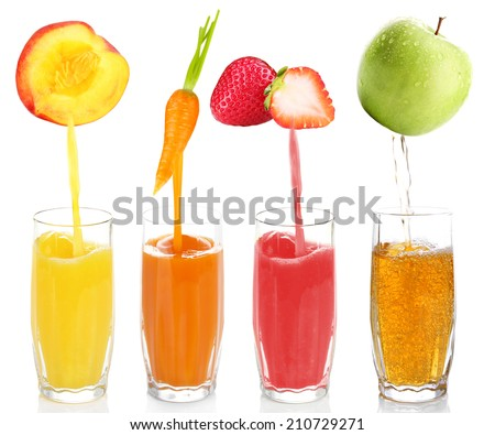 Juice pouring from fruits and vegetables into glass, isolated on white - stock photo