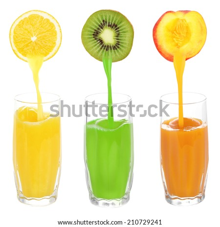 Juice pouring from fruits into glass, isolated on white - stock photo