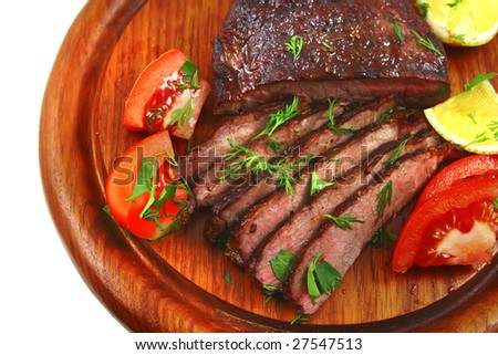 juice roast meat on wood shelf with tomato - stock photo