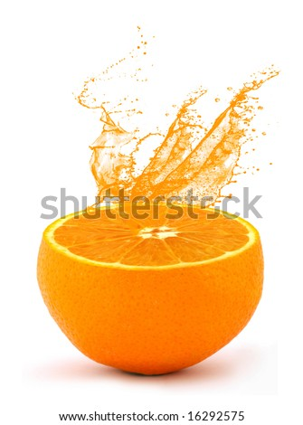 Juice squirting from an orange - stock photo