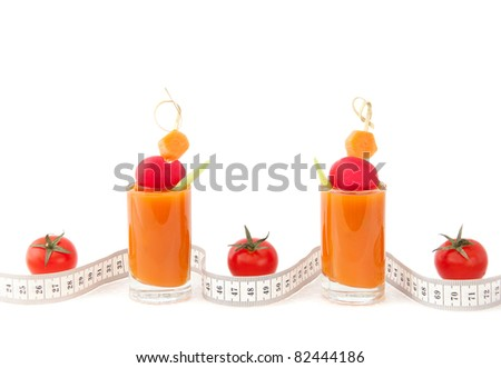 Juice, tomatoes and tape measure's waves - stock photo