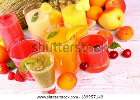 Juice with kiwi, apricot, cherry, melon, tangerine and pear, top view