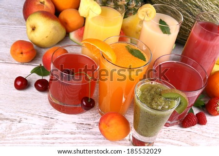 Juice with kiwi, apricot, cherry, watermelon, tangerine and pear, top view - stock photo