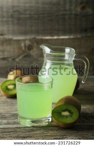 Juice with Kiwi on wooden background