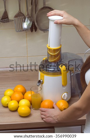 Juicer and fruit orange, with glass of freshness juice. - stock photo