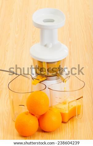 juicer makes delicious fresh orange juice - stock photo