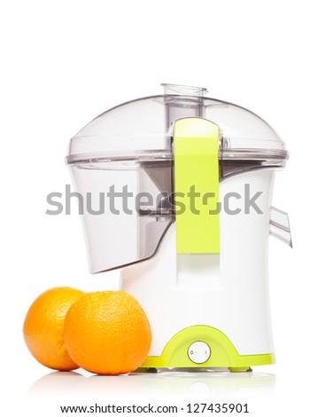 Juicer with two fresh oranges isolated on white background - stock photo