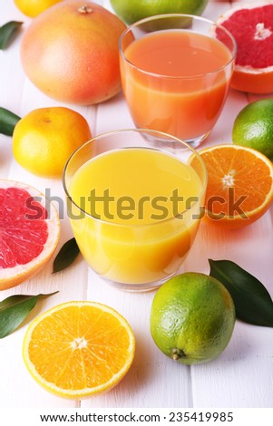 Juices and many citrus close-up