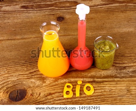 Juices from test tube, biochemistry concept, top view - stock photo