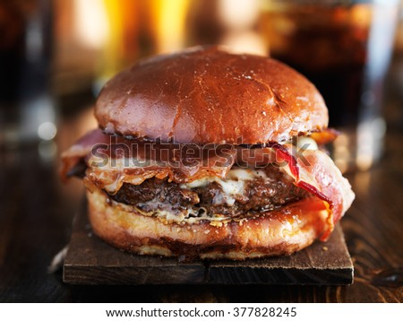 juicey gourmet cheeseburger with melted pepper jack and strips of crispy bacon - stock photo