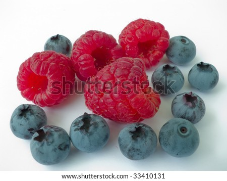 Juicy and fragrant berries of a raspberry and blueberry - stock photo