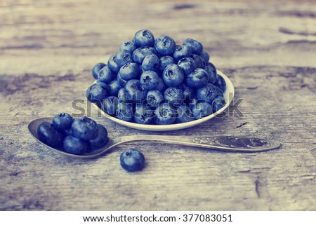 Juicy and fresh blueberries on rustic table. Bilberry on wooden Background. Blueberry antioxidant. Concept for healthy eating and nutrition - stock photo