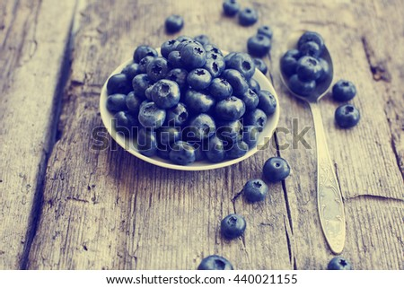 Juicy and fresh blueberries on rustic table. Bilberry on wooden Background. Blueberry antioxidant. Concept for healthy eating and nutrition