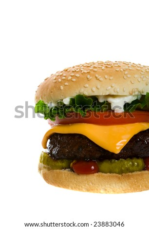 Juicy Angus beef burger topped with cheese, tomatoes & lettuce on a golden sesame seed bun.  Shot on white background.