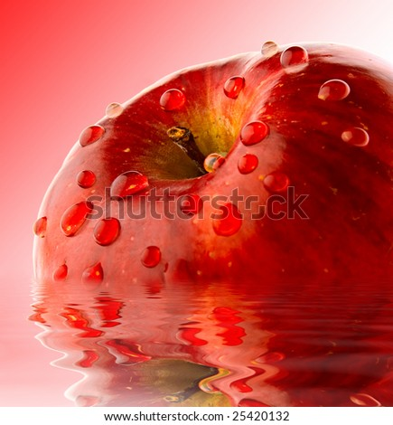 juicy apple isoloated on red background in dewdrop - stock photo