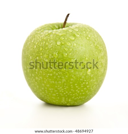 juicy apple with water spray on white background - stock photo