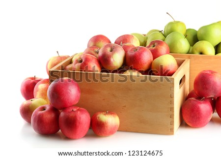juicy apples in wooden crates, isolated on white - stock photo