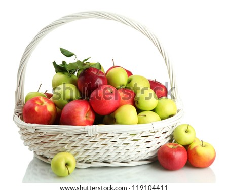 juicy apples with green leaves in basket, isolated on white - stock photo