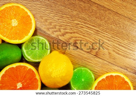 juicy assorted fruit on a wooden background - stock photo