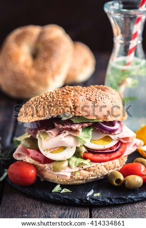 Juicy bagel sandwich with turkey breast and eggs,selective focus - stock photo