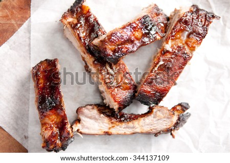 juicy barbeque pork ribs with beer and sauce - stock photo