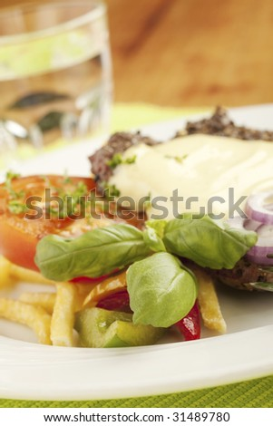 Juicy beefsteak and french fries with tomato and onion rings