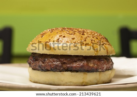 juicy burger served on a plate - stock photo