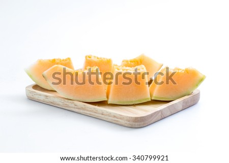 Juicy cantaloupe melon on a wooden plate - stock photo