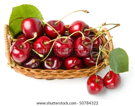 Juicy cherries in the basket isolated on white background