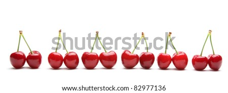 Juicy cherries isolated on white. - stock photo