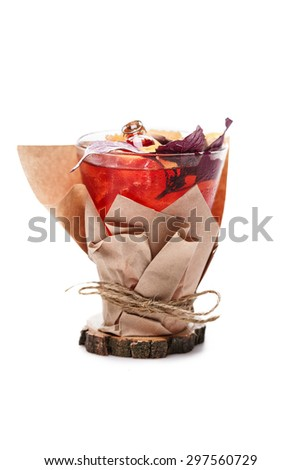 juicy cocktail decorated with basil and paper on white background - stock photo