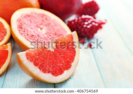 Juicy composition of tropical fruits on wooden background, close up - stock photo