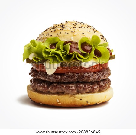 Juicy double burger with pickles, tomatoes and lettuce isolated on white background - stock photo