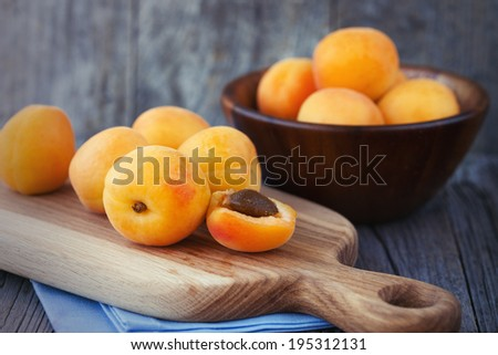 Juicy fresh apricots on a dark wooden background, selective focus - stock photo