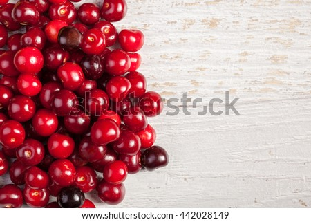 Juicy fresh cherry on wooden background. Vitamin, summer and healthy lifestyle - stock photo