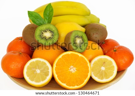 Juicy fresh fruit on a plate. Isolated on a white.