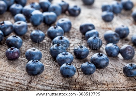 juicy fresh organic blueberries on a rustic background