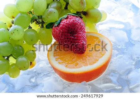juicy fruit on ice - stock photo