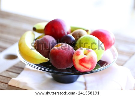 Juicy fruits on wooden table, close-up - stock photo