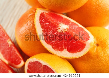 Juicy grapefruits on wooden background, close up - stock photo