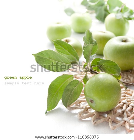 Juicy green apples in basket on the white background - stock photo