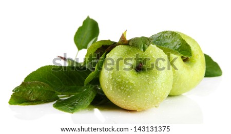 Juicy green apples with leaves, isolated on white - stock photo