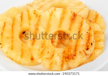 Juicy grilled pineapple on plate close-up - stock photo