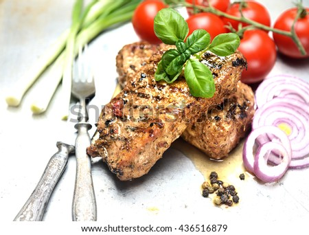 juicy grilled steak, basil and tomatoes - stock photo