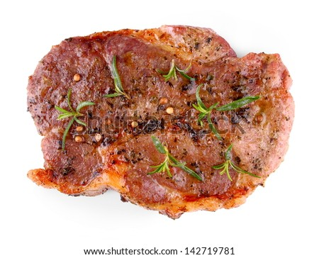 Juicy grilled steak meat with herb marinade, isolated - stock photo