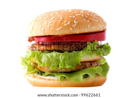 Juicy hamburger with meat and vegetables isolated on a white background